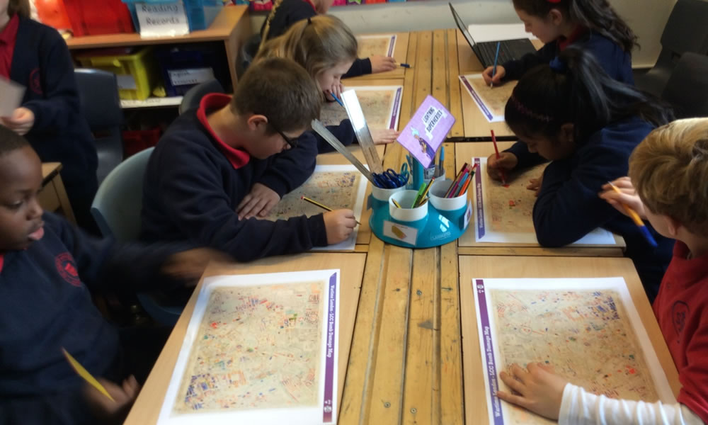 Pupils with maps analysing the blitz